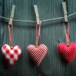 Stock Photo: Valentine's Day wallpaper - Textile hearts hanging on the rope