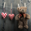 Valentine's Day wallpaper - Teddy Bear hanging with textile hearts — Stock Photo #39689135