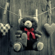 Valentine's Day wallpaper - Teddy Bear hanging with textile hearts — Stock Photo #39689149
