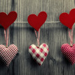 Stock Photo: Textile hearts hanging on the rope - Valentine's Day background