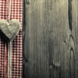 Big heart wood - on plaid fabric — Zdjęcie stockowe
