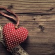 Dotted Fabric heart with lace wood background — Stock Photo
