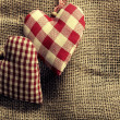 Dotted Fabric heart with lace wood background — Stockfoto