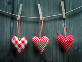 Valentine's Day wallpaper - Textile hearts hanging on the rope — Stock Photo