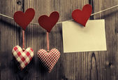 Valentine's Day wallpaper - Textile hearts hanging on the rope, message — Stock Photo
