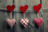 Textile hearts hanging on the rope - Valentine's Day background — Stock Photo