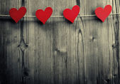 Heart-shaped clips are hanging on the rope, Valentine's Day, love wallpaper — Stock Photo