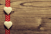 On Red polka dot ribbon, heart-shaped biscuits - wood background — Stock Photo