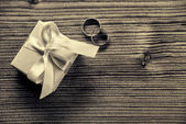 Engagement ring with gift box - wood background — Stock Photo