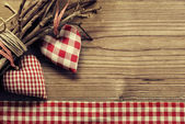 Textile hearts on twig - Harmony background — Stock Photo
