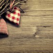 Foto de Stock  : Textile hearts on twig