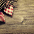 Textile hearts on twig — Stock Photo