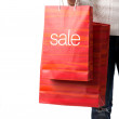 Woman with sale bags — Stock Photo