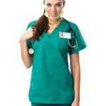 Pretty surgeon in green dress — Stock Photo #41607025