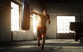 Young man boxing workout in an old building — Stock Photo