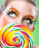 Extremely beauty colorful lollipop, comes with matching makeup — Stock Photo