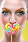 Woman with lollipop and extreme makeup — Foto Stock
