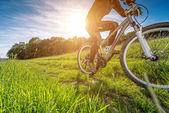 Sport bike cycling in the beautiful meadow — Stock Photo