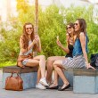 Women chatting on a bench — Stock Photo #47078163