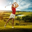 Woman golfer hitting the ball on the beautiful background scenery — Stok fotoğraf #47348593