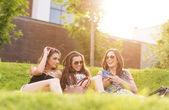 Three Beautiful woman feels good in the grass — Stock Photo
