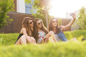 Women enjoying on grass. — Stock Photo