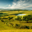 Hilly landscape with lake — Stock Photo #48320435