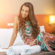 Woman in the bed of a hotel room — Stock Photo #49328295