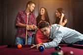 Friends during playing billiard — Stock Photo