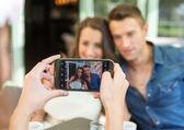 Smiling friends taking selfie photo — Stock Photo