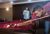 Friends during playing billiard — Stockfoto