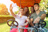 People in a four-wheeled bicycle — Стоковое фото