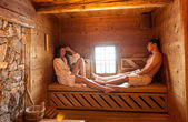 Young couple in sauna — Stock Photo