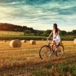 Woman cycling on old bike — Stock Photo #50245003