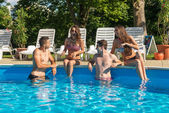 Friends having fun in pool — Stock Photo