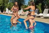 Friends having fun in pool — Stock Photo