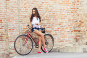 Woman with old red bike — Stok fotoğraf