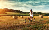 Woman cycling on old bike — Stock Photo
