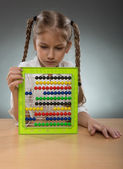 Little girl use abacus board — Stock Photo
