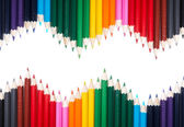 Colored pencil triangle shape — Stock Photo