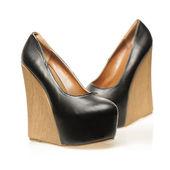 Hoge hakken schoenen in wig ontwerp en met platform — Stockfoto