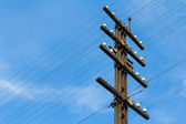 Old electricity post in blue sky — Stock Photo