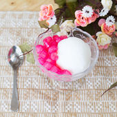 White ice cream made from coconut and pink jelly topping on the — ストック写真
