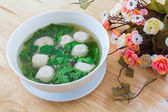 Thai style soup with meatballs and vegetables — Stock Photo