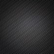 Sheet of metal covered with lines of circular holes — Stock Photo #41288153