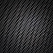 Sheet of metal covered with lines of circular holes — Stock Photo