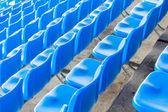 Empty dark blue chairs at the football Stadium  — Foto Stock