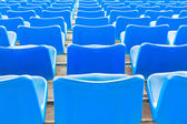 Empty dark blue chairs at the football Stadium  — Stock Photo
