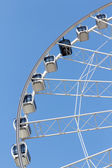 Ferris wheel in the park with clear blue sky and empty space for — Stock Photo