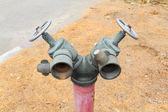 Stary wtyk czerwony metalik fire hydrant — Zdjęcie stockowe